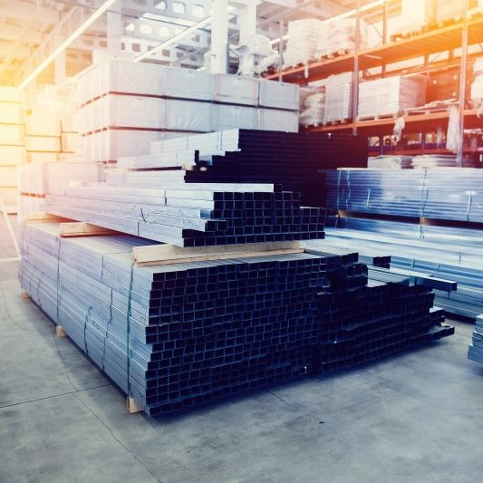 Picture of a stocked lumber warehouse with the help of building material recruiters.